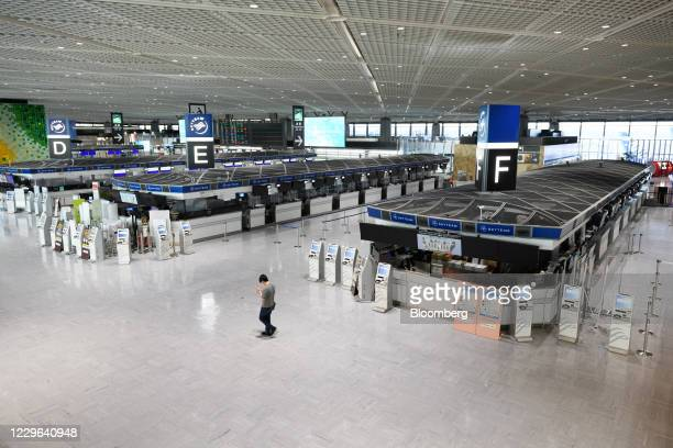 Bloomberg Best of the Year 2020: A man walks through a near-empty departures hall of Narita Airport during the Covid-19 pandemic in Narita, Chiba...