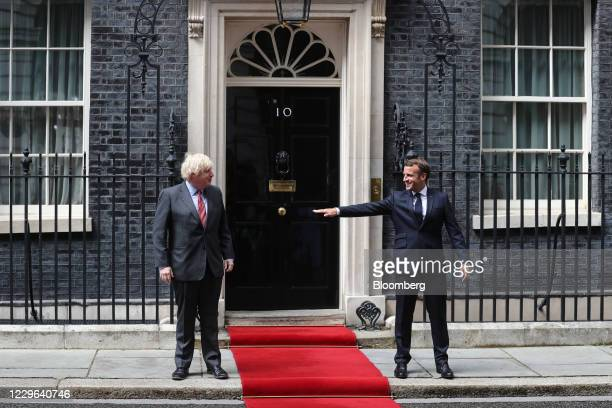 Bloomberg Best of the Year 2020: Boris Johnson, U.K. Prime minister, left, stands at a social distance from Emmanuel Macron, France's president, as...