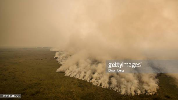 Bloomberg Best of the Year 2020: Fires burn on farmland and smoke covers the horizon across the Pantanal Wetlands in Mato Grosso state, Brazil, on...