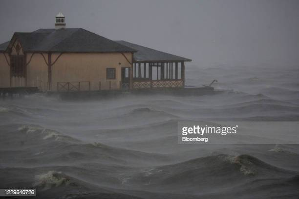 Bloomberg Best of the Year 2020: Storm surge moves past a boathouse in Lake Charles as Hurricane Delta makes landfall in Lake Charles, Louisiana,...