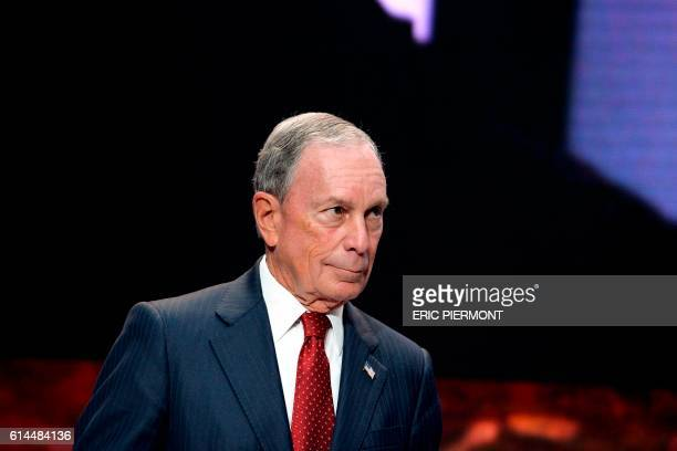 Bloomberg LP CEO Michael Bloomberg arrives for a plenary session along with former French Economy Minister Emmanuel Macron at the Hello Tomorrow...