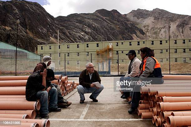 Bloomberg News reporter Elliot Smith center interviews painters at a former stateowned mine camp that is now owned by Aluminum Corp of China known as...