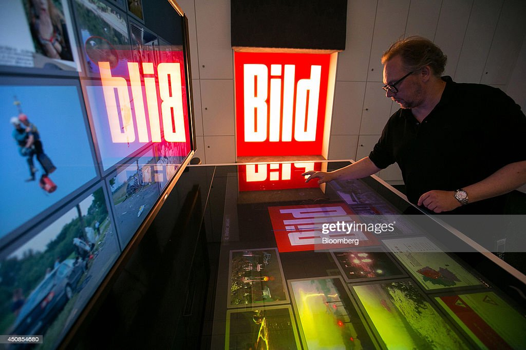 Bloomberg Photo Service 'Best of the Week': Chris Simon, managing editor of Bild, a tabloid newspaper, uses a touch screen panel as he edits images on the digital photo desk inside the offices of newspaper publisher Axel Springer SE, in Berlin, Germany, on Wednesday, June 11, 2014. Axel Springer SE, Europe's biggest newspaper publisher, is working with JPMorgan Chase & Co. and Citigroup Inc. on an initial public offering of its digital-classifieds business, people familiar with the matter said. Photographer: Krisztian Bocsi/Bloomberg via Getty Images