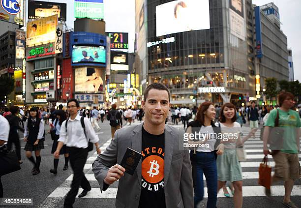 Bloomberg Photo Service 'Best of the Week' Roger Ver founder of Passports for Bitcoincom holds his passport as he poses for a photograph in the...