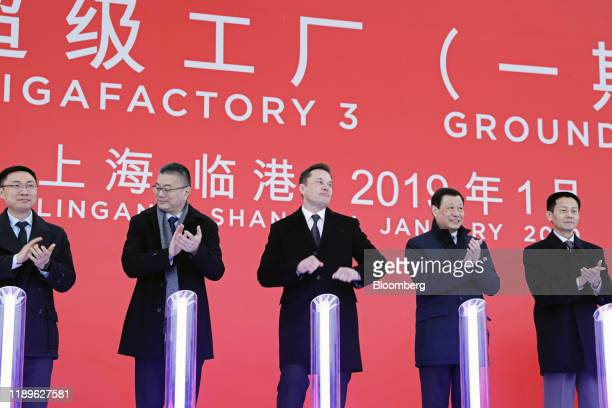 Extreme Business Elon Musk chief executive officer of Tesla Inc center reacts as Robin Ren vice president of sales second left Ying Yong mayor of...