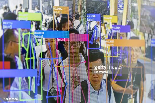Bloomberg Pictures Of The Year 2019: Tech Unchecked. A screen demonstrates facial-recognition technology at the World Artificial Intelligence...