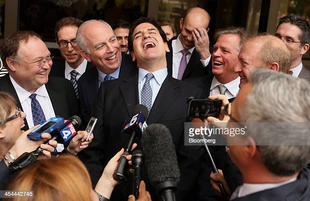 Bloomberg's Best Photos 2013 Mark Cuban billionaire owner of the NBA Dallas Mavericks basketball team center laughs while speaking to the media after...