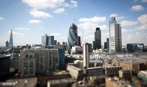 Bloomberg's Best Photos 2013 Skyscrapers rise from the City of London left to right The Shard skyscraper 20 Fenchurch Street also known as the...