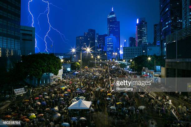 Bloomberg's Best Photos 2014 A lightning strike is seen over skyscrapers as demonstrators gather outside the central government complex as they...