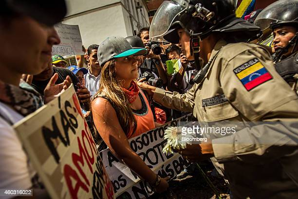 Bloomberg's Best Photos 2014 A police office accepts a flower from a protester during a demonstration by a group made up of mostly students in...