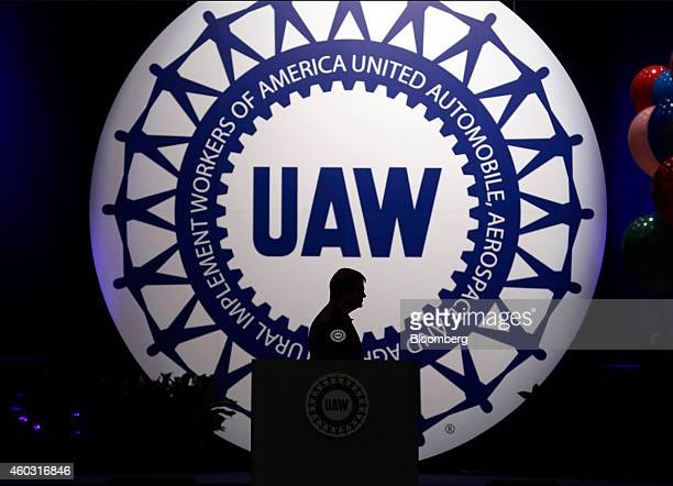 Bloomberg's Best Photos 2014 Bob King president of the United Auto Workers is silhouetted as he stands at the podium during the UAW 36th...