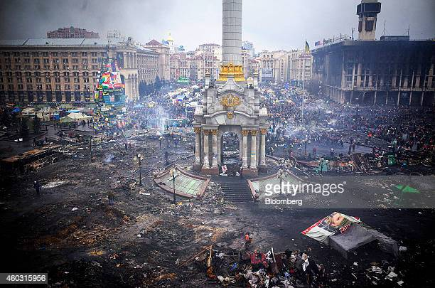 Bloomberg's Best Photos 2014 Protestors inspect damage caused by recent antigovernment protests on Independence Square following recent clashes in...