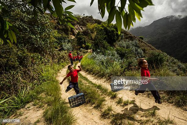 Bloomberg's Best Photos 2014 School children jump hurdles constructed of Pepsi crates during gym class at Culebrilla elementary school in Culebrilla...