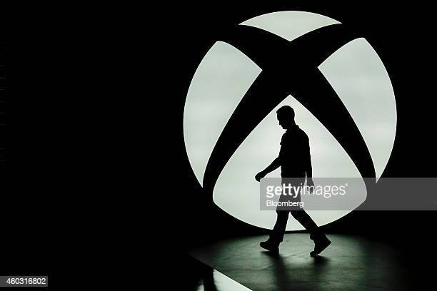 Bloomberg's Best Photos 2014: The silhouette of Ralph Fulton, design director for Forza Horizon at Playground Games, is seen walking past the...
