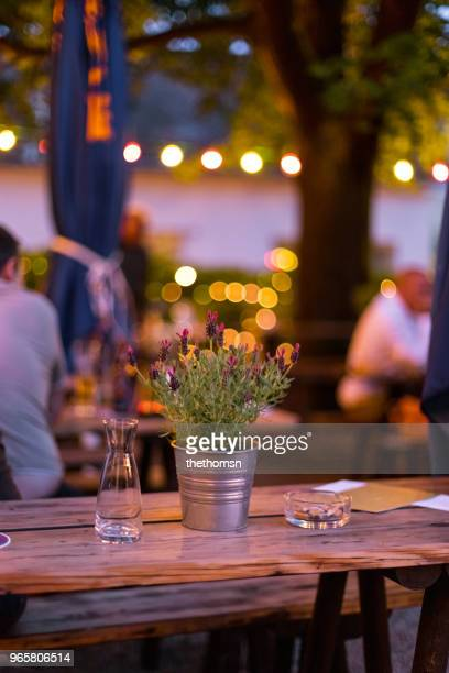 blooming lavender on wooden table at outdoor area of a restaurant