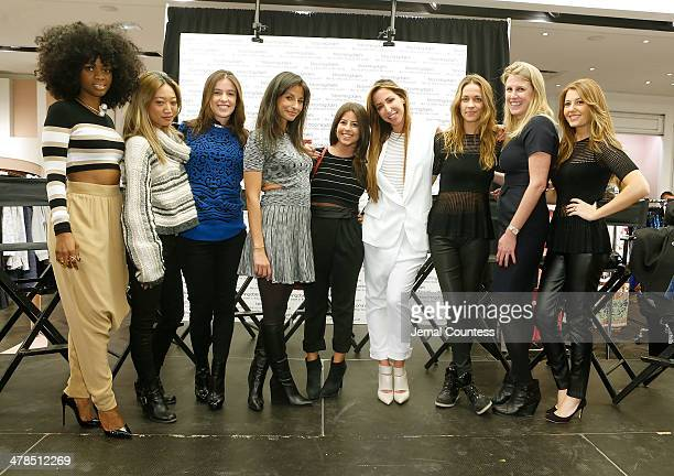 Bloomingdales Director of Marketing and Sales Robyn Davidson and designer Ronny Kobo pose with the team of Torn by Ronny Kobo at the Collective...