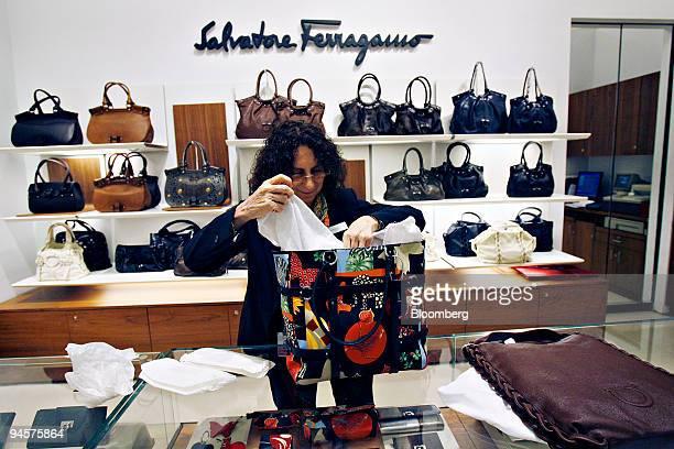 Bloomingdale's sales associate prepares a Salvatore Ferragamo handbag for display at Bloomingdale's in New York Monday July 23 2007 Store policy...