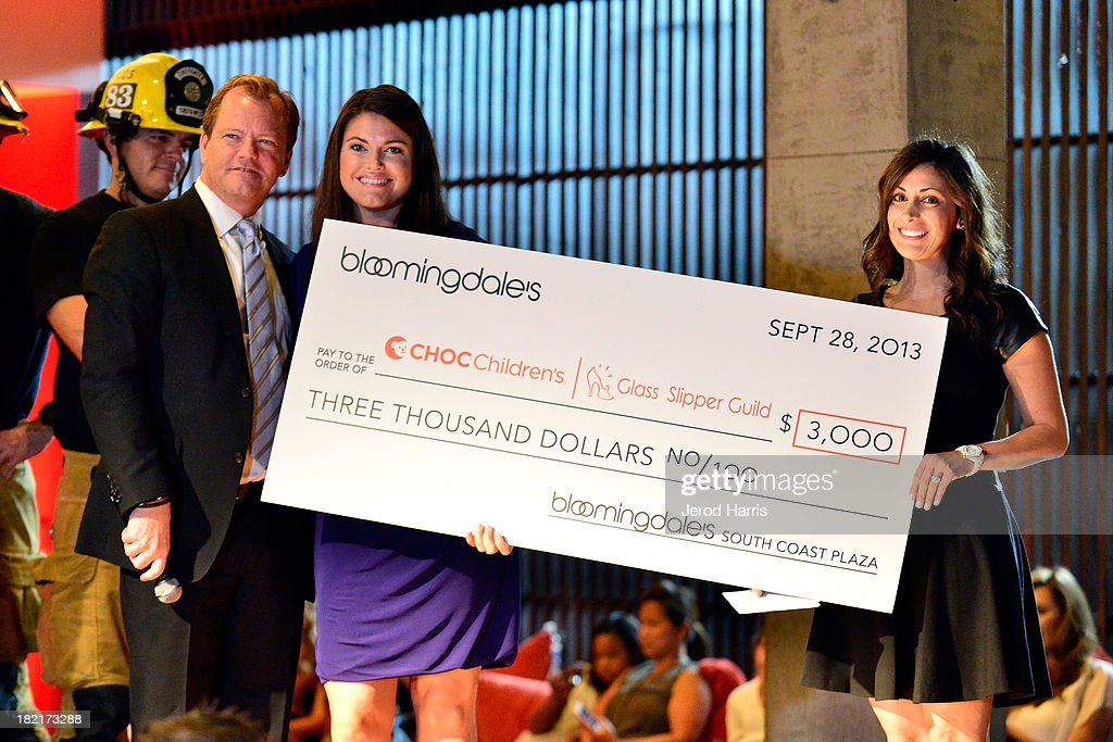 Bloomingdales South Coast Plaza General manager Jim Murphy, co president Bobbie Garza and co president Natalie Wackeen attend the Costa Mesa Firefighter Fashion Show benefitting CHOC Children's Glass Slipper Fund at AnQi Gourmet Bistro & Noodle Bar on September 28, 2013 in Costa Mesa, California.