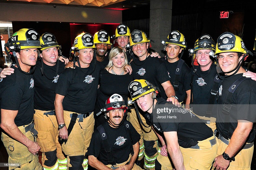Bloomingdales South Coast Plaza Public Relations Manager Jaime Strong (center) poses with firefighters from the Costa Mesa Fire Department at the Costa Mesa Firefighter Fashion Show benefitting CHOC Children's Glass Slipper Fund at AnQi Gourmet Bistro & Noodle Bar on September 28, 2013 in Costa Mesa, California.