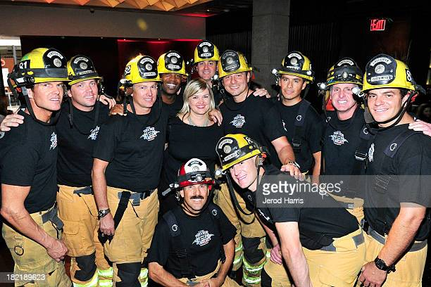 Bloomingdales South Coast Plaza Public Relations Manager Jaime Strong poses with firefighters from the Costa Mesa Fire Department at the Costa Mesa...