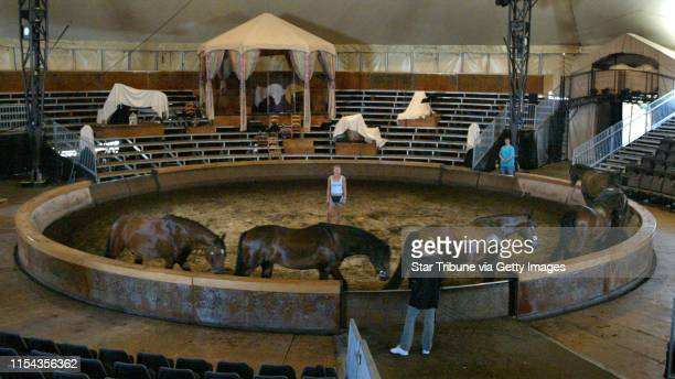 Bloomington MN. 7/3/2002--Cheval--Caroline Williams works with her 6 horses during a morning liberty practice inside the circus tent that she will be...
