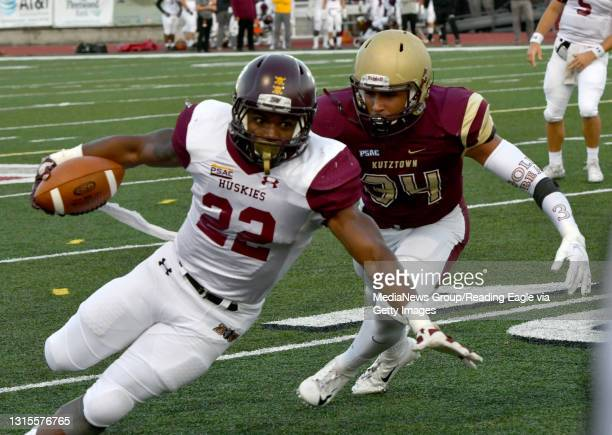 Bloomsburg's Alex Gooden goes down with Kutztown's Shawn Turber-Ortiz in pursuit. FOOTBALL - The Kutztown Golden Bears defeated the Bloomsburg...