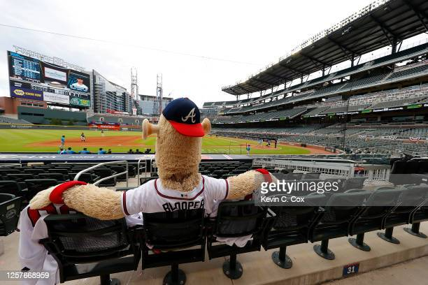 Blooper, mascot of the Atlanta Braves, sits in the empty stands to watch the exhibition game between the Atlanta Braves and the Miami Marlins at...