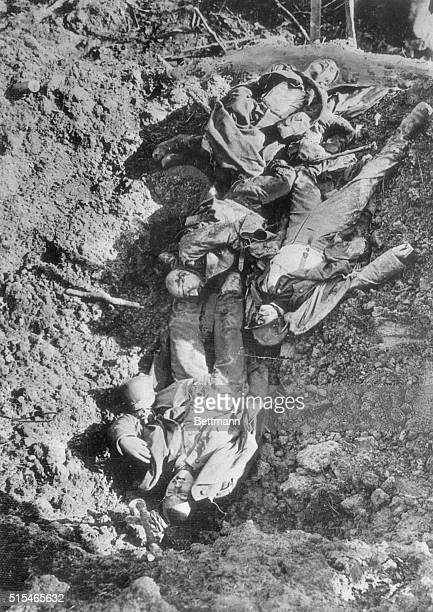 Blotted outWhile the terrific battle swept on these dead Germans who helped to launch it were left sprawled in the trench where they fell They were...