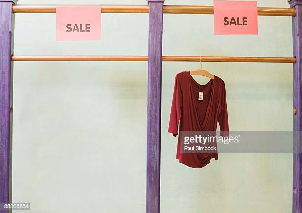 blouse hanging on sale rack in shop - blouse stock pictures, royalty-free photos & images