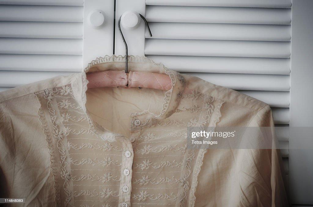 Blouse hanging on wardrobe door : Stock Photo