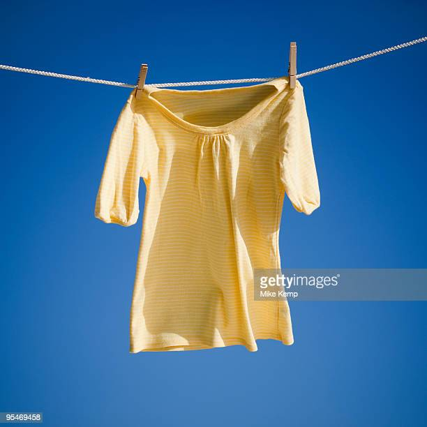 blouse on clothes line - blouse stock pictures, royalty-free photos & images