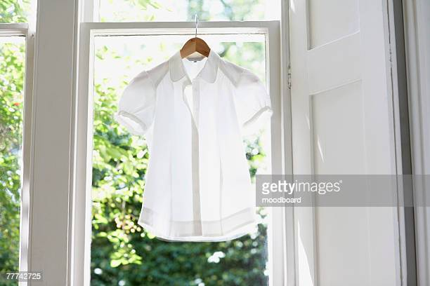 blouse on hanger - blouse stockfoto's en -beelden