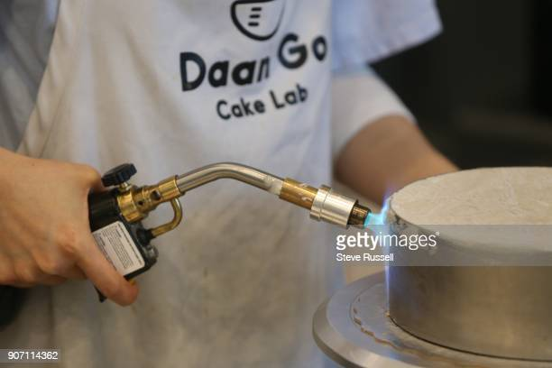 TORONTO ON JANUARY 12 A blow torch is used o loosen a mould from a frozen cake Daan Go Cake Lab opened at 3380 Midland Road by owner Christopher Siu...
