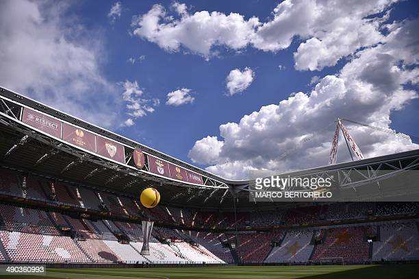 A blow up of the Europa league trophy floats over the pitch prior to the start of the UEFA Europa league final football match between Benfica and...