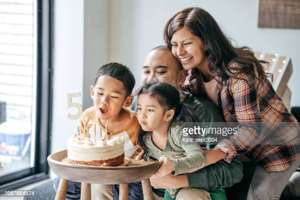 blowing birthday candles - happy birthday canada stock pictures, royalty-free photos & images