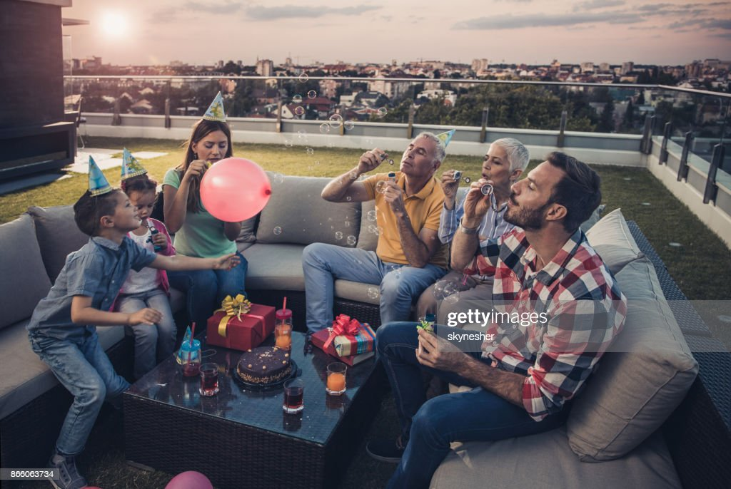 Blowing bubbles on a Birthday party! : Stock Photo