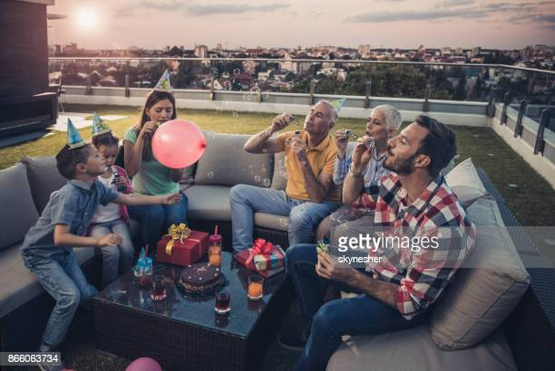 blowing bubbles on a birthday party! - penthouse girls stock pictures, royalty-free photos & images