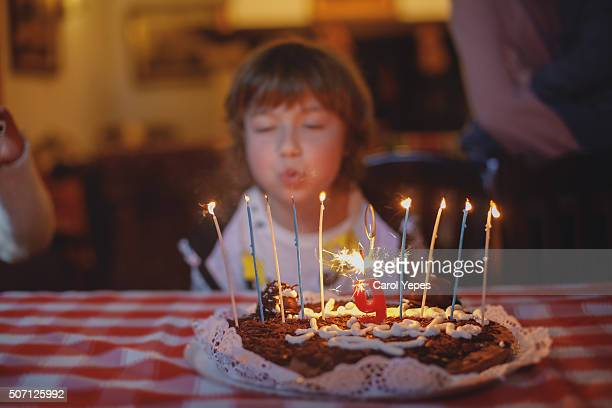 blowing candles - couple tongue kissing stock photos and pictures
