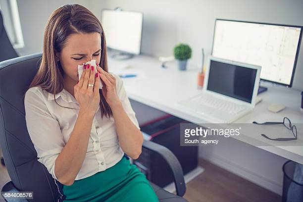 blowing her nose - cold virus stock pictures, royalty-free photos & images