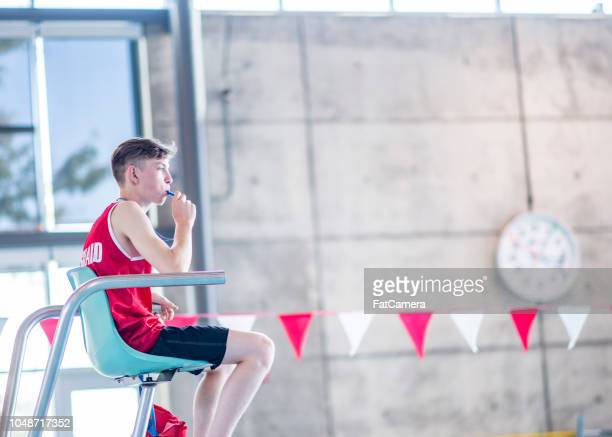 blowing his whistle - lifeguard stock pictures, royalty-free photos & images