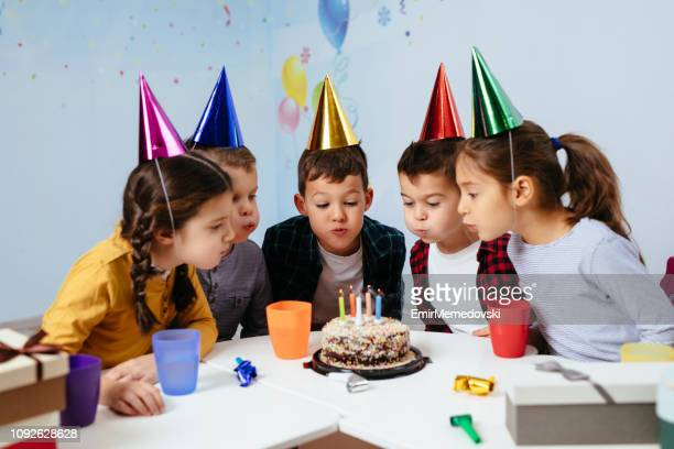 blowing out birthday candles - happy birthday images for sister stock pictures, royalty-free photos & images
