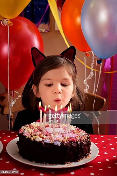 blowing out candles on birthday cake - birthday candle stock pictures, royalty-free photos & images