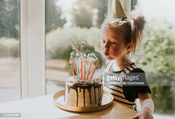 blowing out candles - anniversary stock pictures, royalty-free photos & images