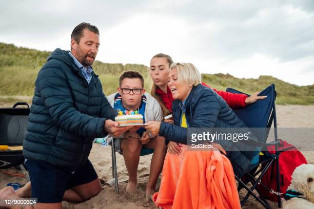 blowing out our candles - birthday stock pictures, royalty-free photos & images