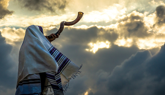 Blowing  the shofar for the Feast of Trumpets 1061644460
