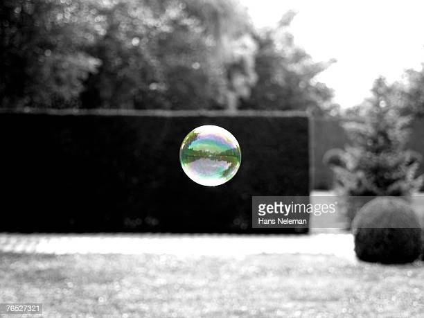 Blown bubble with wall in background
