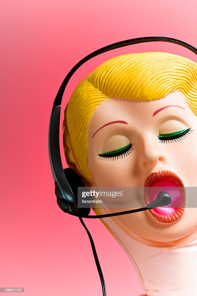 Blow-up Doll Wearing Telephone Headset : Stock Photo
