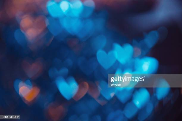 blue abstract background with heat bokeh - valentine's day holiday stock pictures, royalty-free photos & images