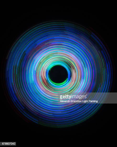 blue abstract circular light painting - lichtmalerei stock-fotos und bilder
