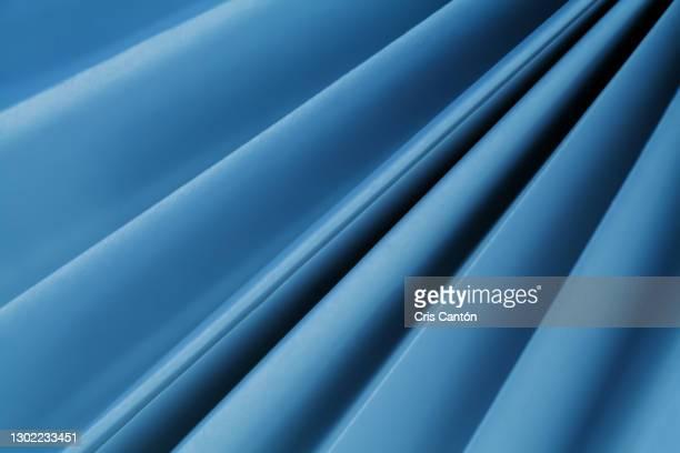 blue abstract diagonal lines background - cris cantón photography fotografías e imágenes de stock